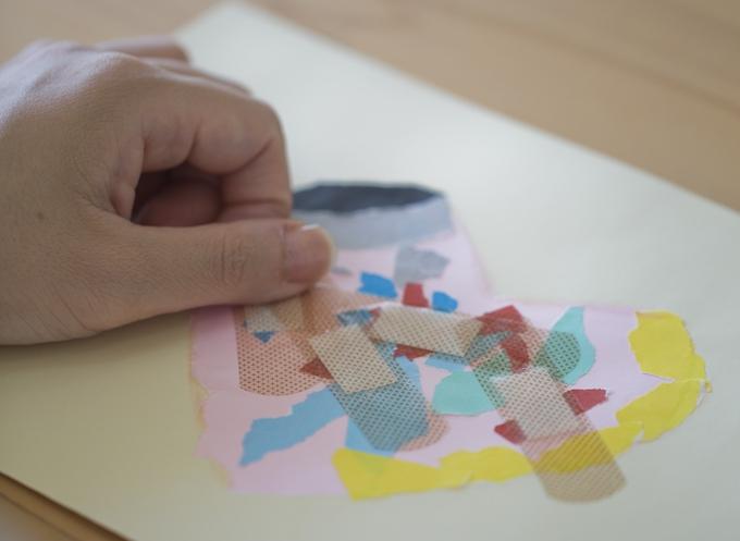 自分の抱えているグリーフを折り紙をつかってハートにあらわして絆創膏を貼るワーク photo by Mina Imai